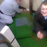 fitting artificial grass december 2012 in the rain
